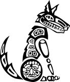 Sitting Coyote. Mythical Coyote rendered in Northwest Coast Native style Royalty Free Stock Photos