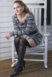Sitting Crossed on the Rocking Chair. Woman sitting on rocking chair on porch Royalty Free Stock Image