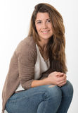Sitting cute girl. Sitting portrait of a cute expressive young woman Stock Photography