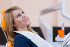 Sitting on the dental chair Royalty Free Stock Images