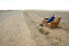 Sitting on a desert sofa Royalty Free Stock Photography