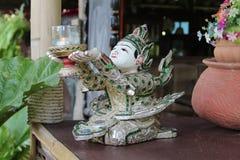 Sitting deva wood carving Stock Image