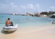 Sitting at Devil's Bay. Teen boy sitting on a raft at Devil's Bay Beach at Virgin Gorda of the British Virgin Islands. If you can, please leave a comment about royalty free stock photos