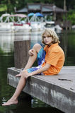 Sitting on a dock in the bay Stock Image