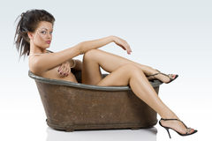 Sitting down il old style bathtub Royalty Free Stock Photography