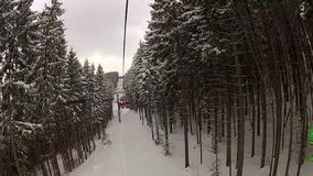 Sitting down on the ski lift in Bukovel stock footage