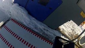 Sitting down on the ski lift in Bukovel stock video