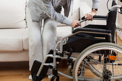 Sitting down on wheelchair Royalty Free Stock Image
