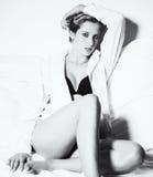 Sitting elegant sexy woman Stock Photos