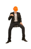 Sitting Engineer in Orange Helmet Pointing Down Stock Photo