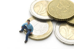 Sitting on Euros Stock Photography