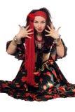 Sitting expressive gypsy woman Royalty Free Stock Photo