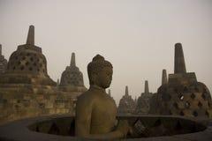 sitting för borobudurbuddha meditation Fotografering för Bildbyråer