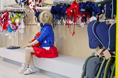 Sitting fashion doll in clothing store Royalty Free Stock Photo