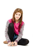 Sitting fashion portrait of young beautiful girl Royalty Free Stock Image