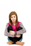 Sitting fashion portrait of young beautiful girl Royalty Free Stock Photography
