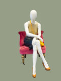 Sitting female mannequin Stock Images