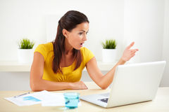 Sitting female receptionist using her computer Stock Photo