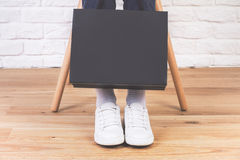 Sitting female with shopping bag Royalty Free Stock Photos