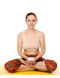 Sitting female yogi with cup Royalty Free Stock Photos