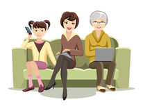 Sitting Females on Couch with Gadgets Stock Images