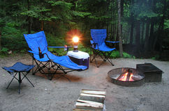 Sitting by the fire at a campsite Royalty Free Stock Image