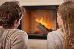 Sitting by fireplace Stock Photography