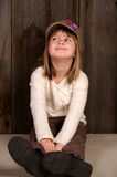 Sitting on the floor. A young girl sitting on the floor and smiling royalty free stock photography