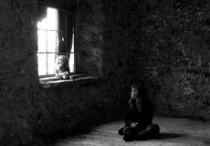 Lonely girl sitting in an abandoned room Royalty Free Stock Photo