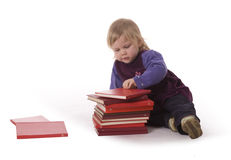 Sitting on the floor baby girl reading books Royalty Free Stock Photos