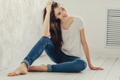 Sitting on the floor. Beautiful girl sitting on the floor Royalty Free Stock Image