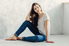 Sitting on the floor. Beautiful girl sitting on the floor Stock Photo
