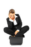 Sitting on floor business woman looking in laptop Royalty Free Stock Photography