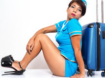 Sitting on the floor with her suitcase Stock Images