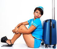 Sitting on the floor with her suitcase Royalty Free Stock Photo