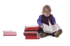 Sitting on the floor little girl reading books Stock Images