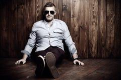 Sitting on a floor man stock photos
