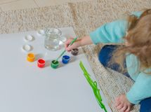 Sitting on the floor, paints, girl stock image