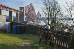 Sitting by the Forth Rail Bridge Royalty Free Stock Images