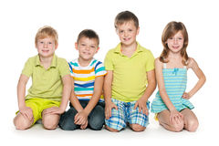 Sitting four cheerful children Royalty Free Stock Photography