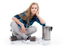 Sitting beside the garbage. Royalty Free Stock Photos