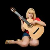 Sitting girl with acoustic guitar Royalty Free Stock Photo