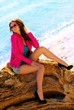 Sitting girl on a beach Stock Photo