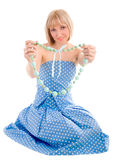 Sitting girl in a blue dress Royalty Free Stock Images