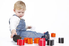 Sitting girl with colourful gift boxes Stock Photo
