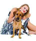 The sitting girl with a dog  isolated Stock Photo
