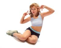 Sitting girl in fitness pose Stock Photography