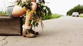 Sitting girl - hitchhiking traveler Royalty Free Stock Photography