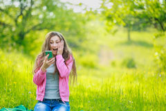 Sitting girl with phone Royalty Free Stock Photo