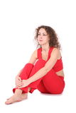Sitting girl in red Stock Images